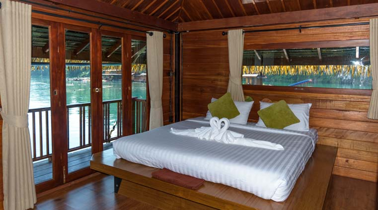 Greenery Panvaree Floating Raft House Resort Cheow Lan Lake Chiewlarn Lake Khao Sok National Park Thailand King bed room Greenery Zone