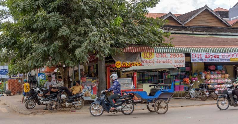 Tuk-tuks and motorbikes Siem Reap Cambodia