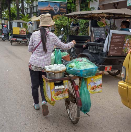 Bicycle with a heavy load in Siem Reap Cambodia