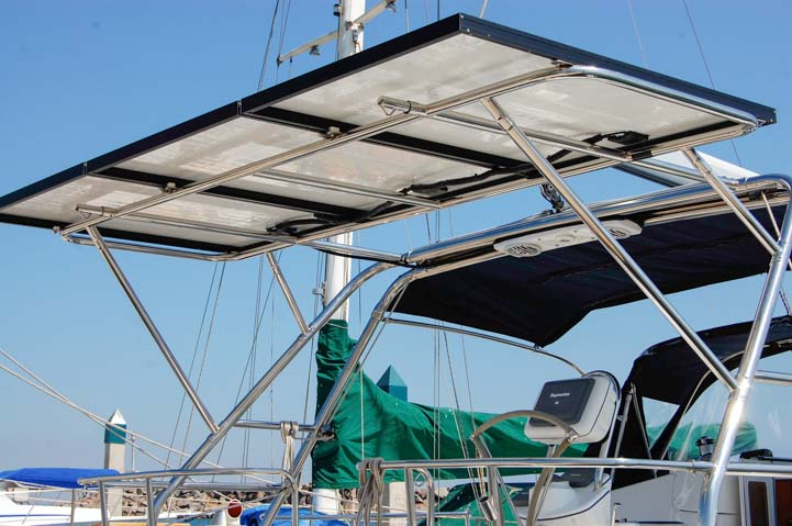 Solar panel arch with dinghy davit extension supporting affordable solar power on sailboat