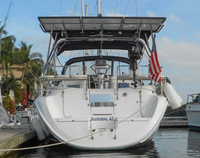 Solar panel arch and solar panels on sailboat transom
