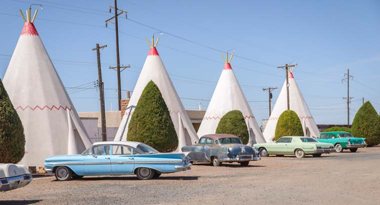 Antique cars and tee-pees at Wigwam Motel Holbrook Arizona Route 66