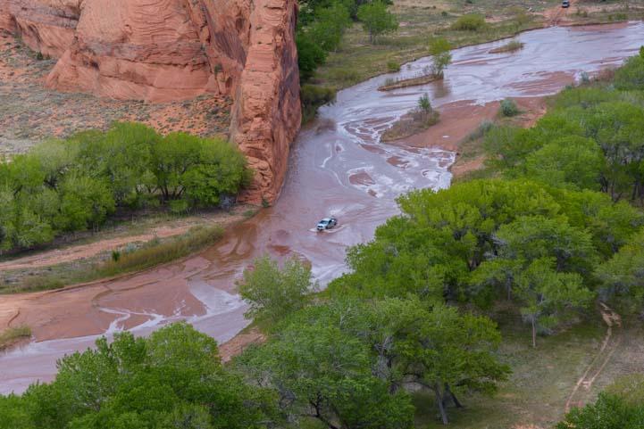 Car driving in wash at Tsegi Overlook Canyon de Chelly National Monument Arizona