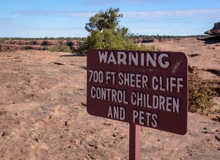 Sheer cliff warning sign Canyon de Chelly National Monument Arizona