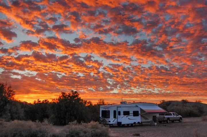 Arizona sunset over fifth wheel trailer RV