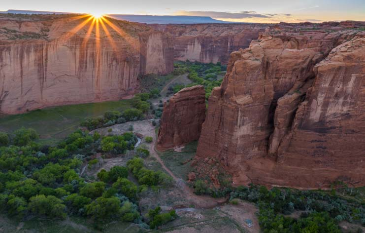 Starburst sunset Sliding House Ruin Canyon de Chelly National Monument Arizona