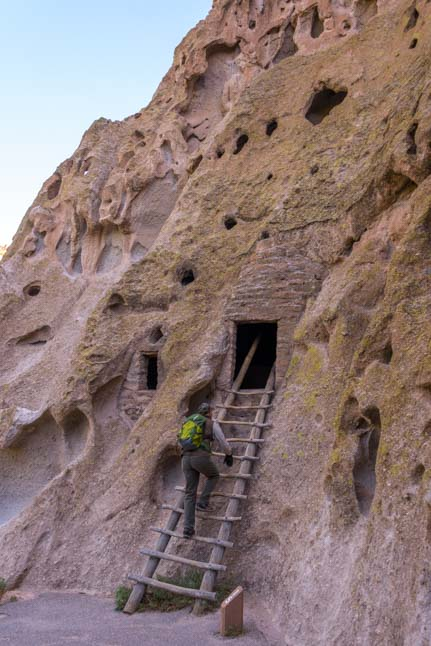 Climbing ladder to cliff dwelling Bandelier National Monument New Mexico