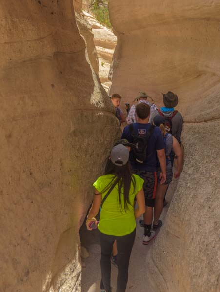 Crowds on slot canyon hike Tent Rocks National Monument New Mexico