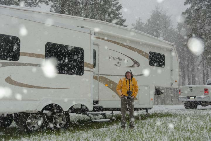 Snow storm in an RV in the woods