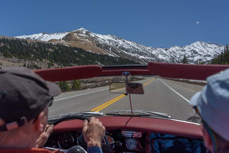 View from back seat of Porsche 356 convertible in Colorado