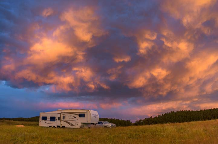 Fifth wheel trailer RV camping at sunset