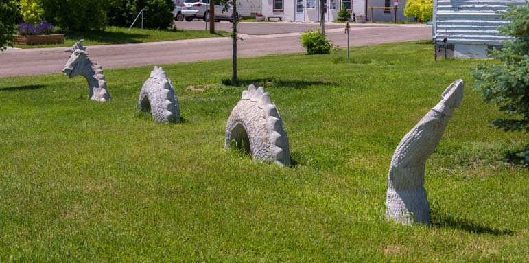 Chugwater Wyoming Dragon in the grass sculpture