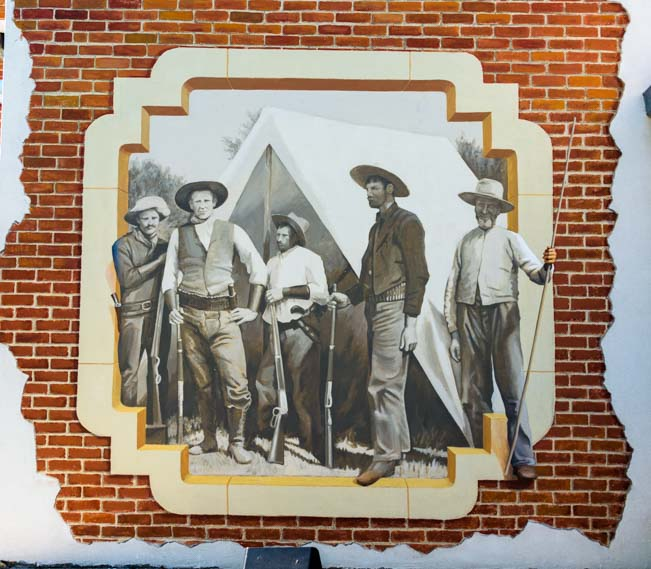 "Old cowboys in ""More than a One Horse Town' mural Buffalo Wyoming by Aaron Wuerker"