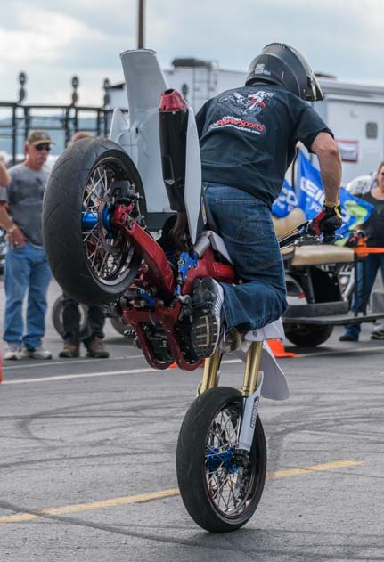 Front wheelie bike tricksters Sturgis Motorcycle Rally South Dakota