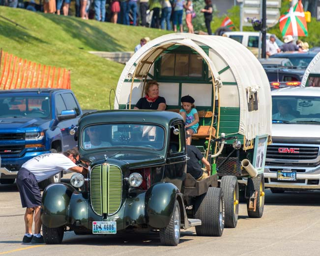 Basque wagon towed by antique car Basque Festival Buffalo Wyoming