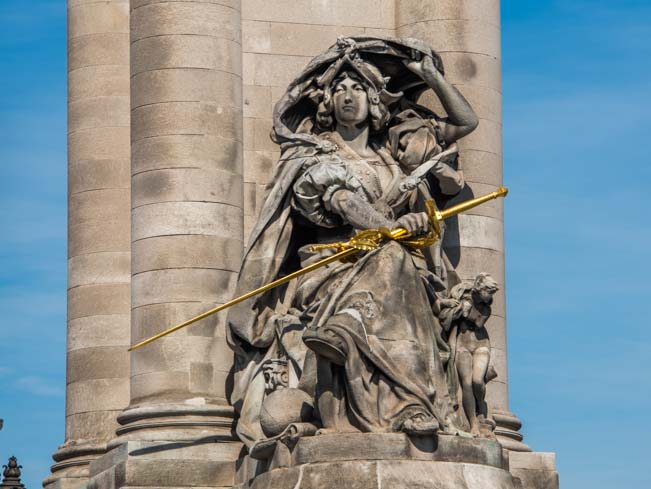 Statue with gold leaf sword Alexander Bridge Paris France