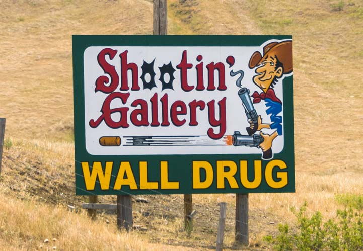 Wall Drug Store Shootin Gallery highway sign in South Dakota