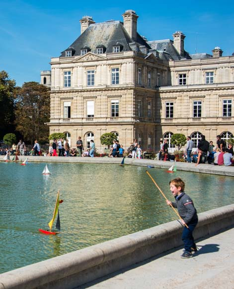 Child with a sailboat Luxembourg Gardens Paris