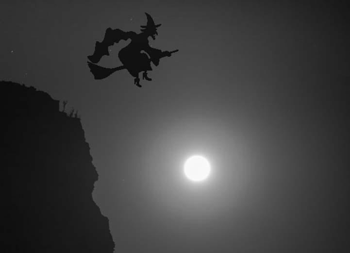 Happy Halloween witch flies over the moon on a broomstick-min