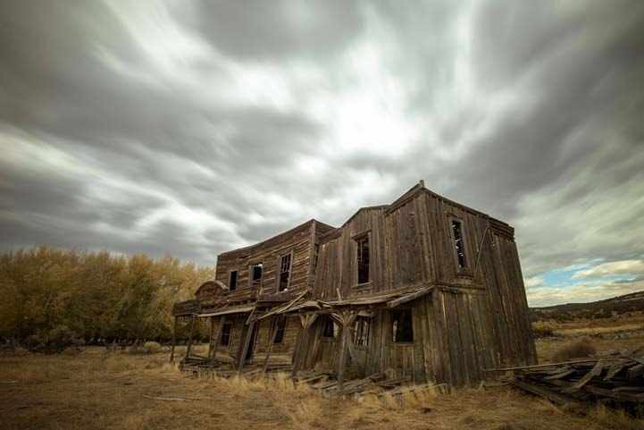Stormy skies ghost town at Johnson Canyon movie set Kanab Utah-min