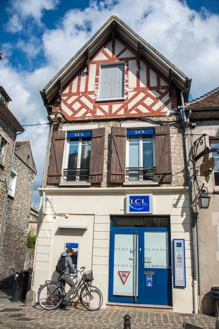 ATM in antique building Moret sur Loing France-min