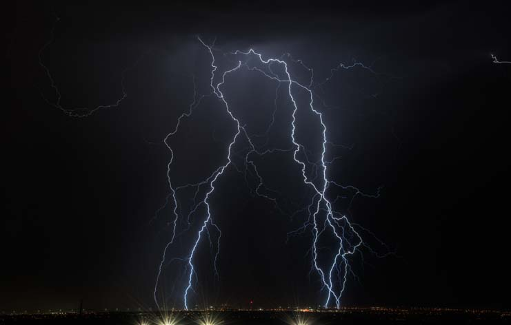 Lightning storm over city lights of Las Vegas Nevada