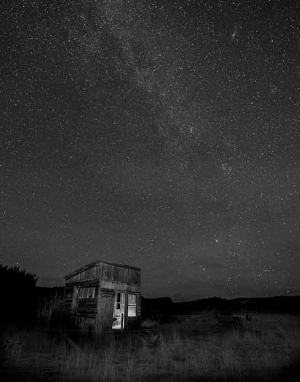 Milky Way over old cabin Johnson Canyon Utah-8