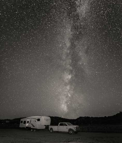 Fifth Wheel trailer RV under the milky way black and white-min