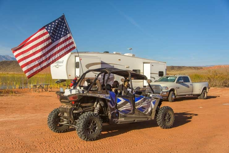 Polaris RZR 4-seater UTV with RV camping at Sand Hollow State Park Utah-min