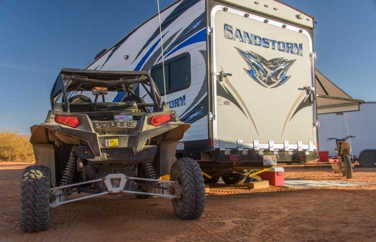 Toy hauler fifth wheel and Polaris RZR UTV RV camping-min