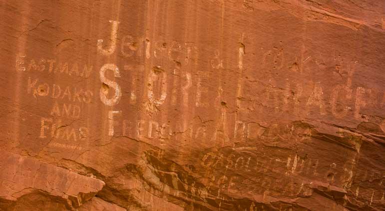 Old sign on red rocks near Kanab Utah-min