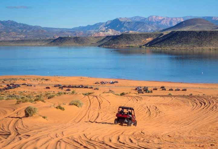 Driving Polaris side-by-side buggies at Sand Hollow State Park Utah-min