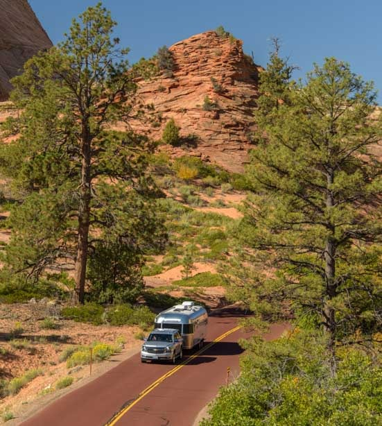 Airstream trailer drives scenic road to Zion National Park Utah-min