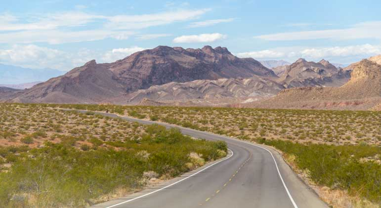 Scenic RV driving on by Lake Mead Nevada-min
