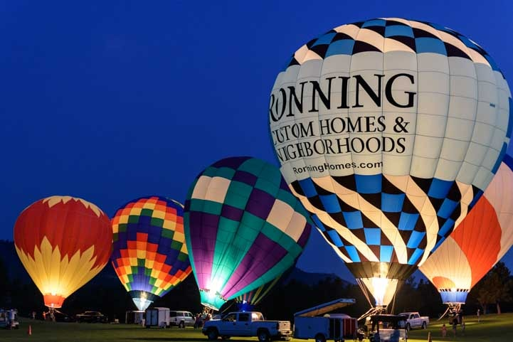 The balloon glow at Fall River Balloon Festival Hot Springs South Dakota-min