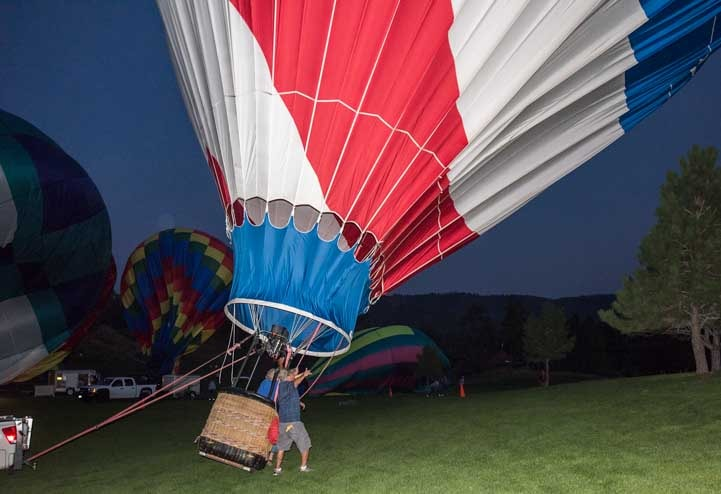Inflating a hot air balloon at the balloon glow Fall River Balloon Festival South Dakota-min