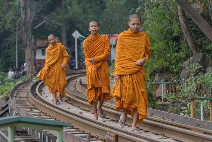 Buddhist monks on train tracks Death Railway Kanchanaburi Thailand copy-min