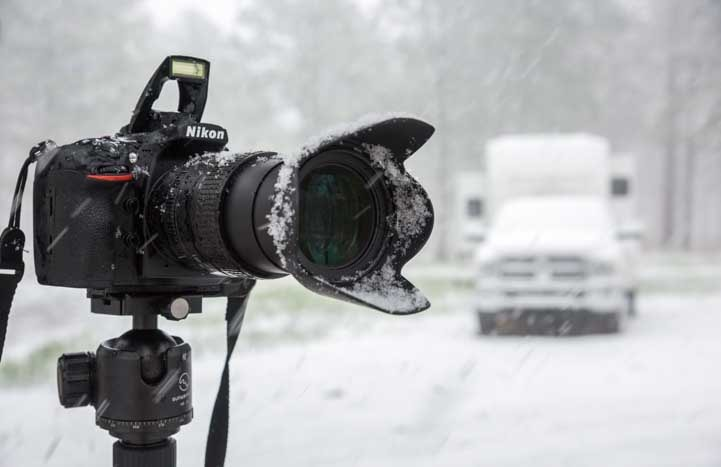 Camera in a spring snowstorm with fifth wheel RV-min
