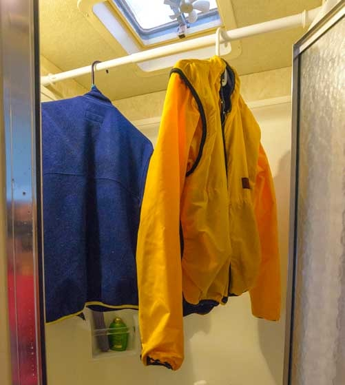 Snowstorm in an RV drying jackets in the shower-min
