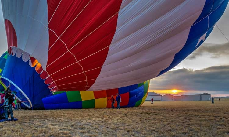 Sunrise under a hot air balloon-min