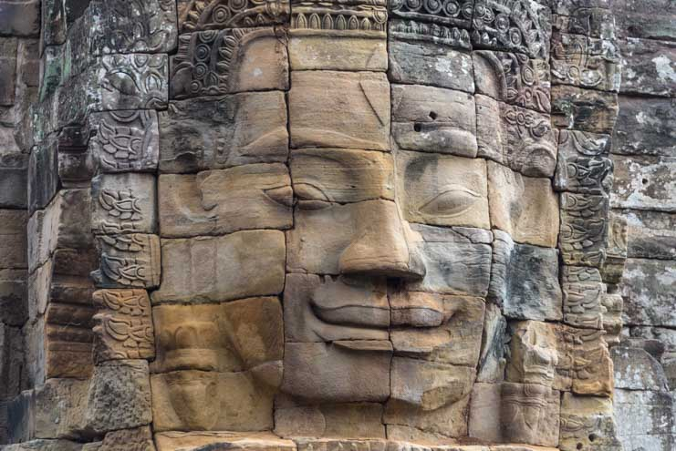 Face in the ruins at Angkor Wat Cambodia travel-min