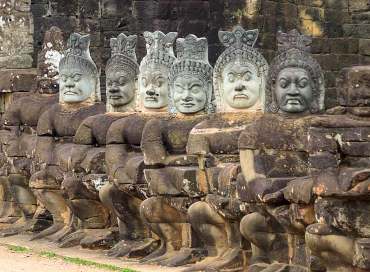 Faces at the gate Angkor Wat temple Cambodia travel-min
