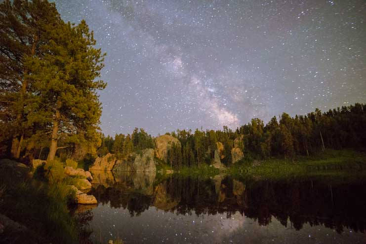 Milky Way reflects in a lake in Black Hills South Dakota RV trip-min