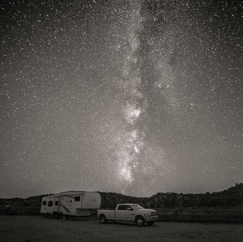 Fifth wheel RV under the Milky Way-min