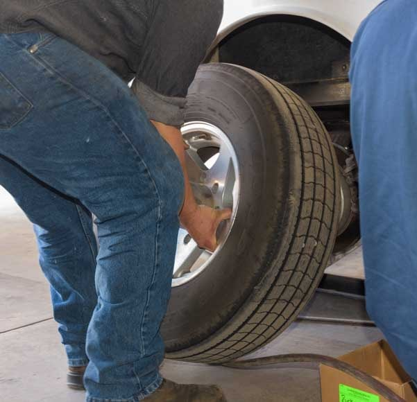 Remove wheel from fifth wheel to grease wheel bearings-min