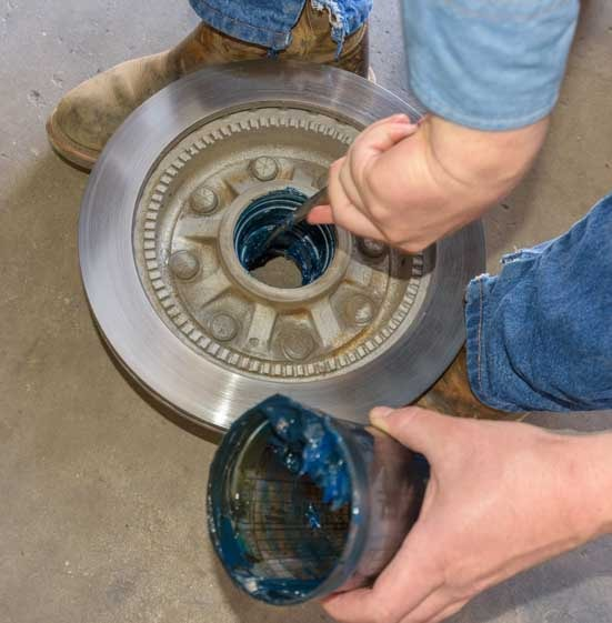Greasing wheel bearings on fifth wheel trailer remove old grease-min