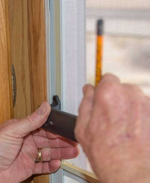 Expand RV screen door handle and mark the proper width on it with a pencil-min