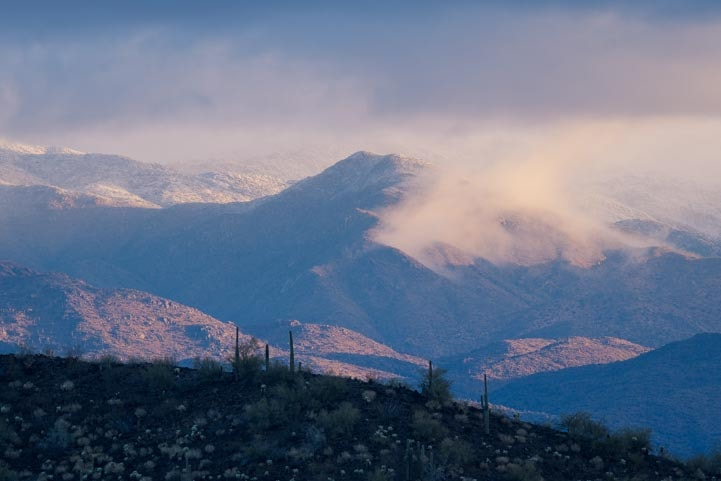 Fog mist and snow in Arizona Sonoran Desert mountains-min