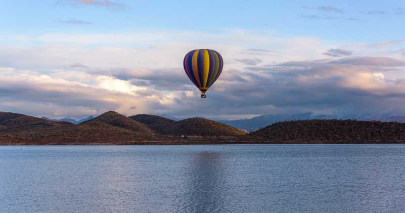 Balloon flies over Lake Pleasant Arizona-min