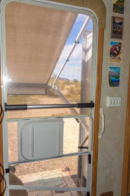 RV screen door handle installed on RV screen door-min